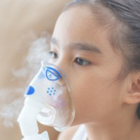 Image of young girl using respiratory device